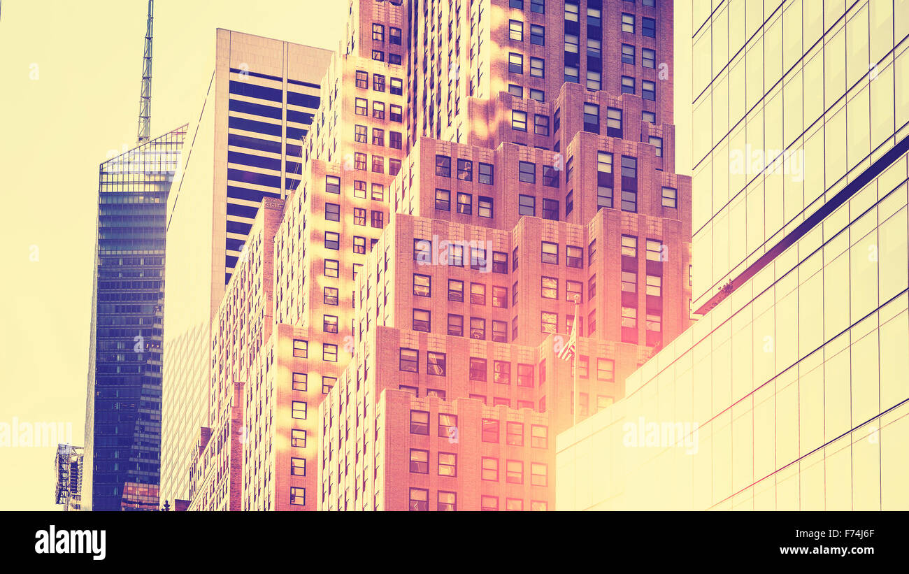 Vintage toned high key picture of skyscrapers against sun, New York, USA. - Stock Image