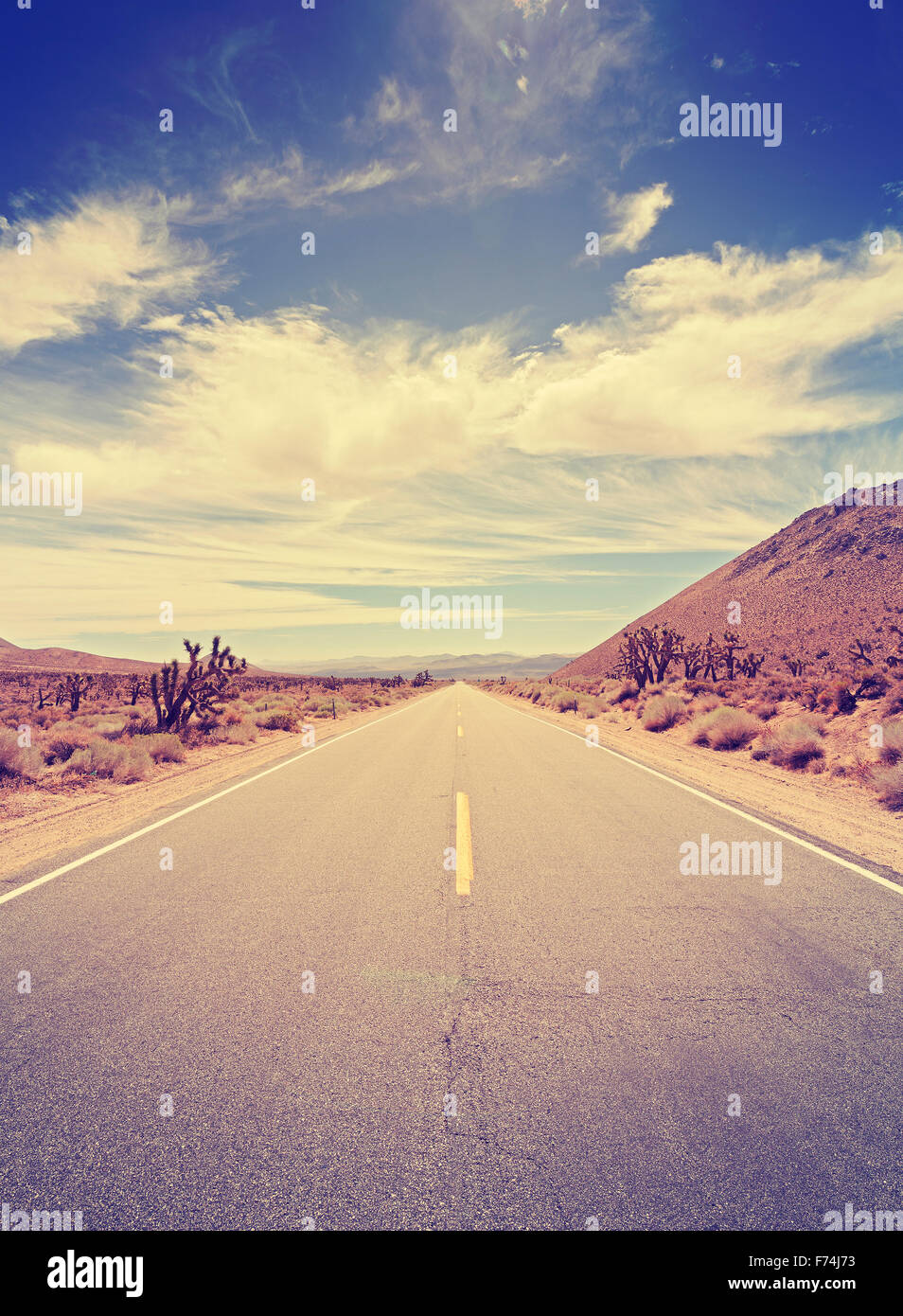 Vintage toned endless country highway in Death Valley, California, USA. - Stock Image