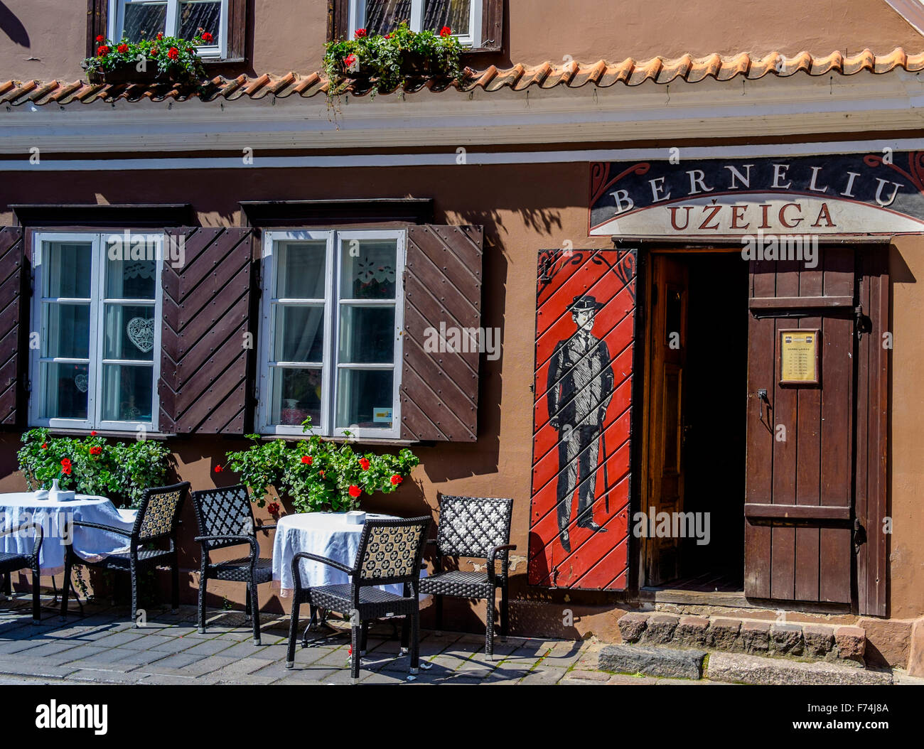 Berneliu Uzeiga serving traditional Lithuania dishes in Old Town Kuanas - Stock Image