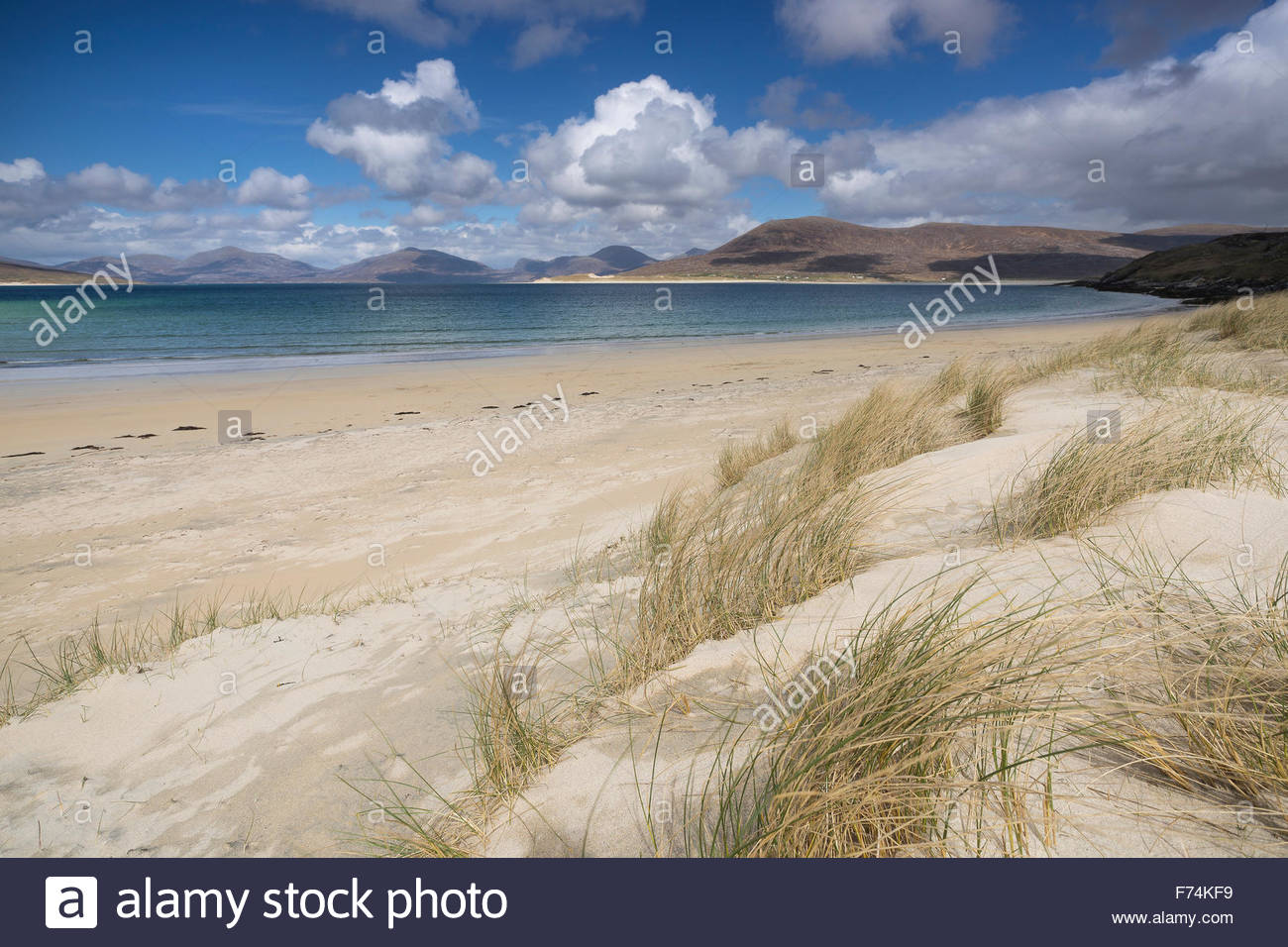 A view from the dunes at Horgabost beach across the sound of Taransay to the hills beyond, Isle of Harris, Outer - Stock Image