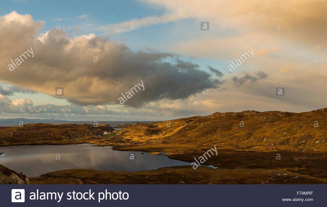 An view across Loch na Criadhach with a golden early morning light, Isle of Harris, Outer Hebrides, Scotland - Stock Image