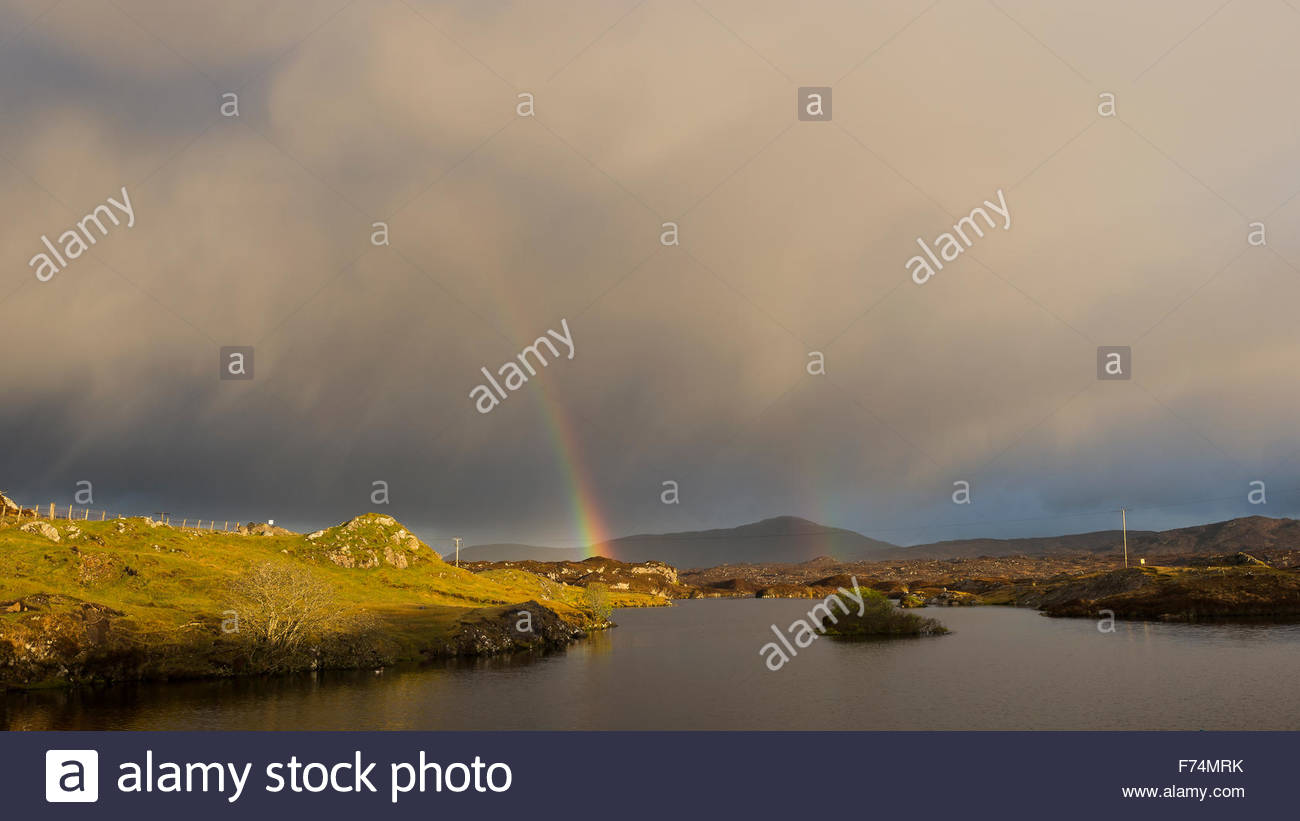 A rainbow and hail shower over Loch Huamnabhat, Isle of Harris, Outer Hebrides, Scotland - Stock Image