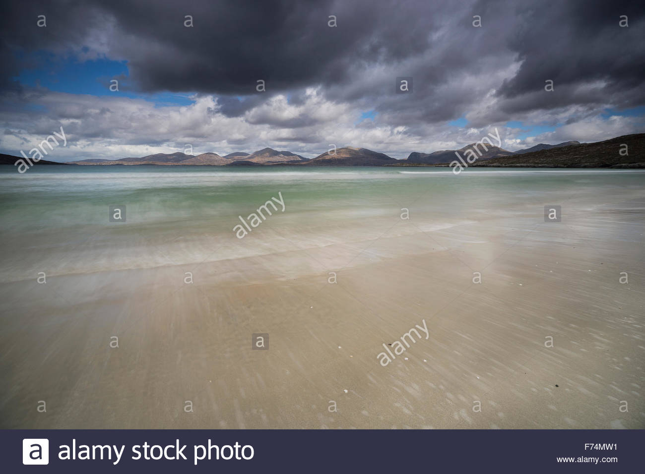 The ebb and flow of the tide at Luskentyre looking across the sound of Taransay to the hills beyond, Isle of Harris, - Stock Image