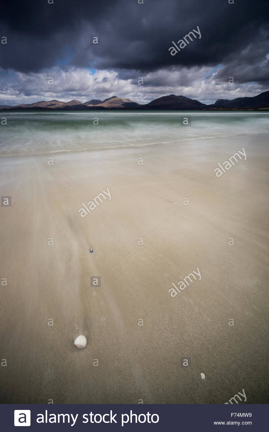 The ebb and flow of the tide at Luskentyre looking across the sound of Taransay to the hills beyond, Isle of Harris, Stock Photo