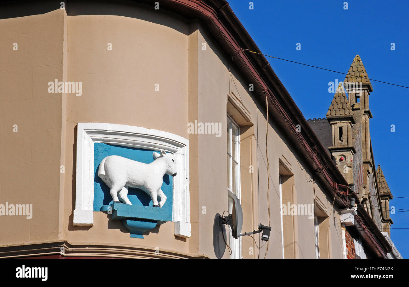 Sculpture on a building in Tiverton, indicating the importance of the town's wool trade in its history. - Stock Image