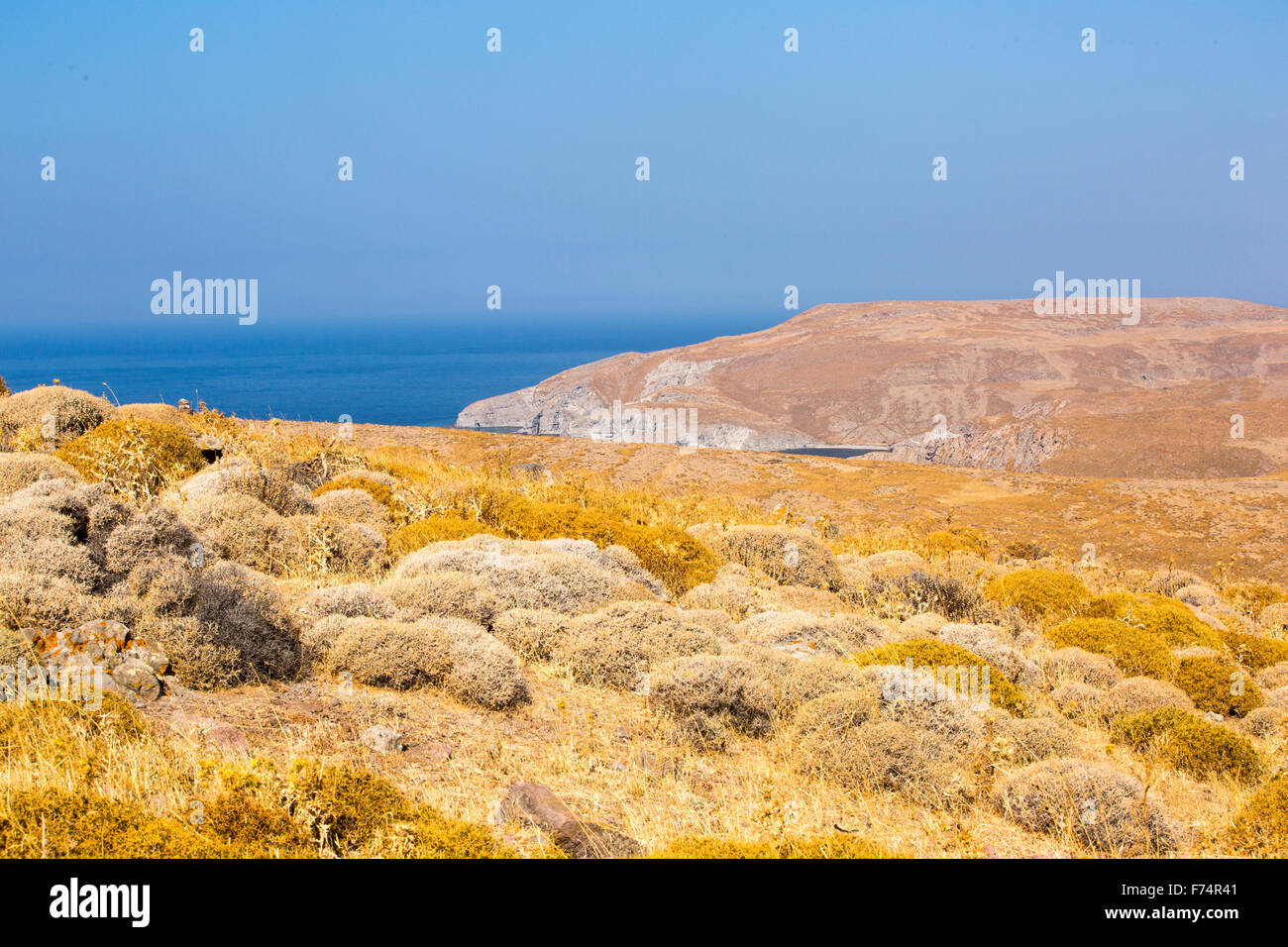 Barren rocky hillsides with sparce thorny vegetation on Western Lesvos above Skala Eresou, Lesvos, Greece. Stock Photo