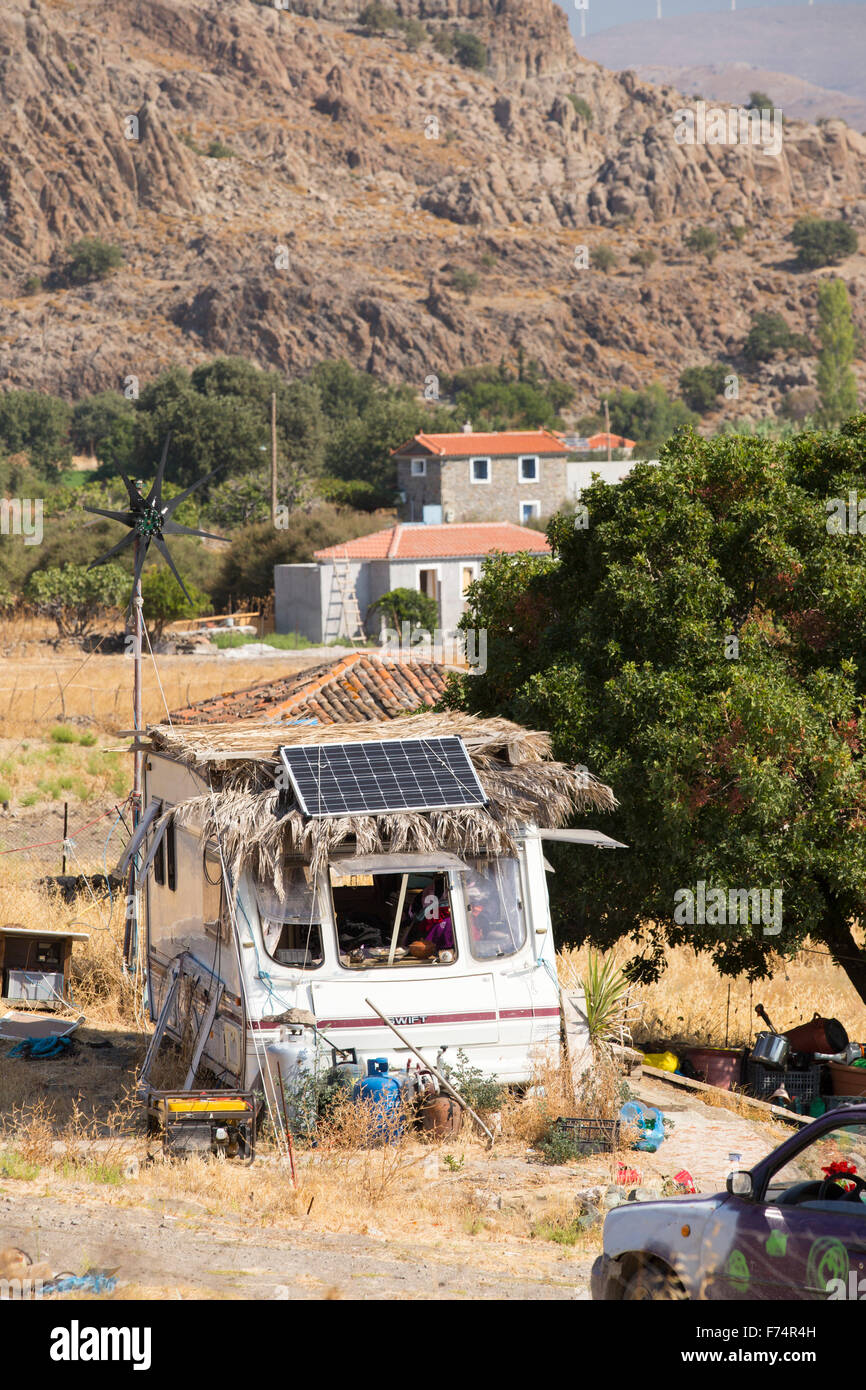A caravan with a wind turbine and solar panel in Skala Eresou, on Lesvos, Greece. Stock Photo