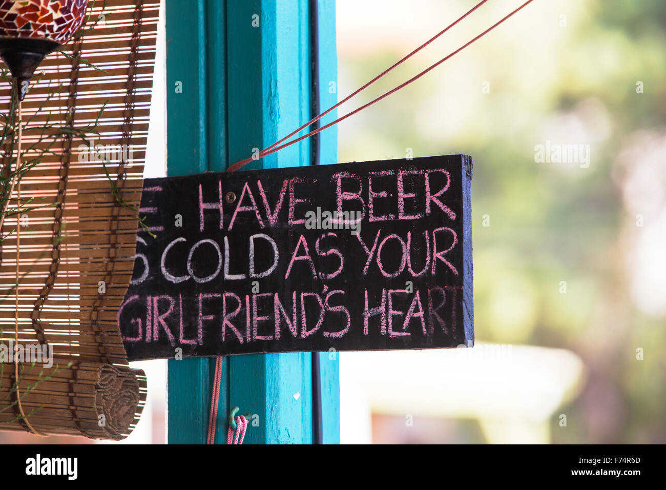 A fun sign in a taverna on the sea front in Skala Eresou, on Lesvos, Greece, which is favoured by the many lesbians Stock Photo