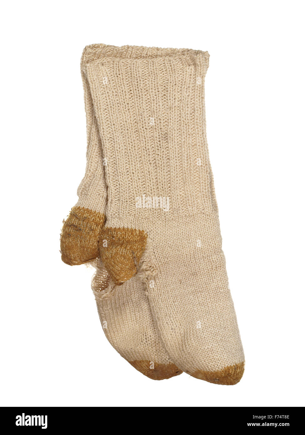 Old ragged woolen socks isolated on a white background. - Stock Image