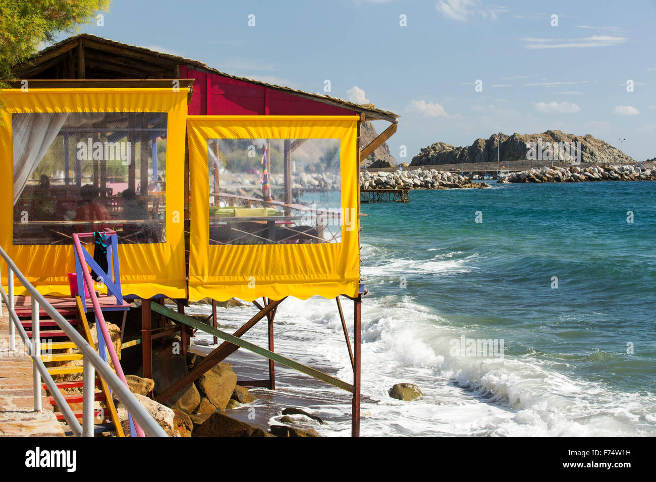 A taverna on the sea front in Skala Eresou, on Lesvos, Greece, which is favoured by the many lesbians who flock Stock Photo