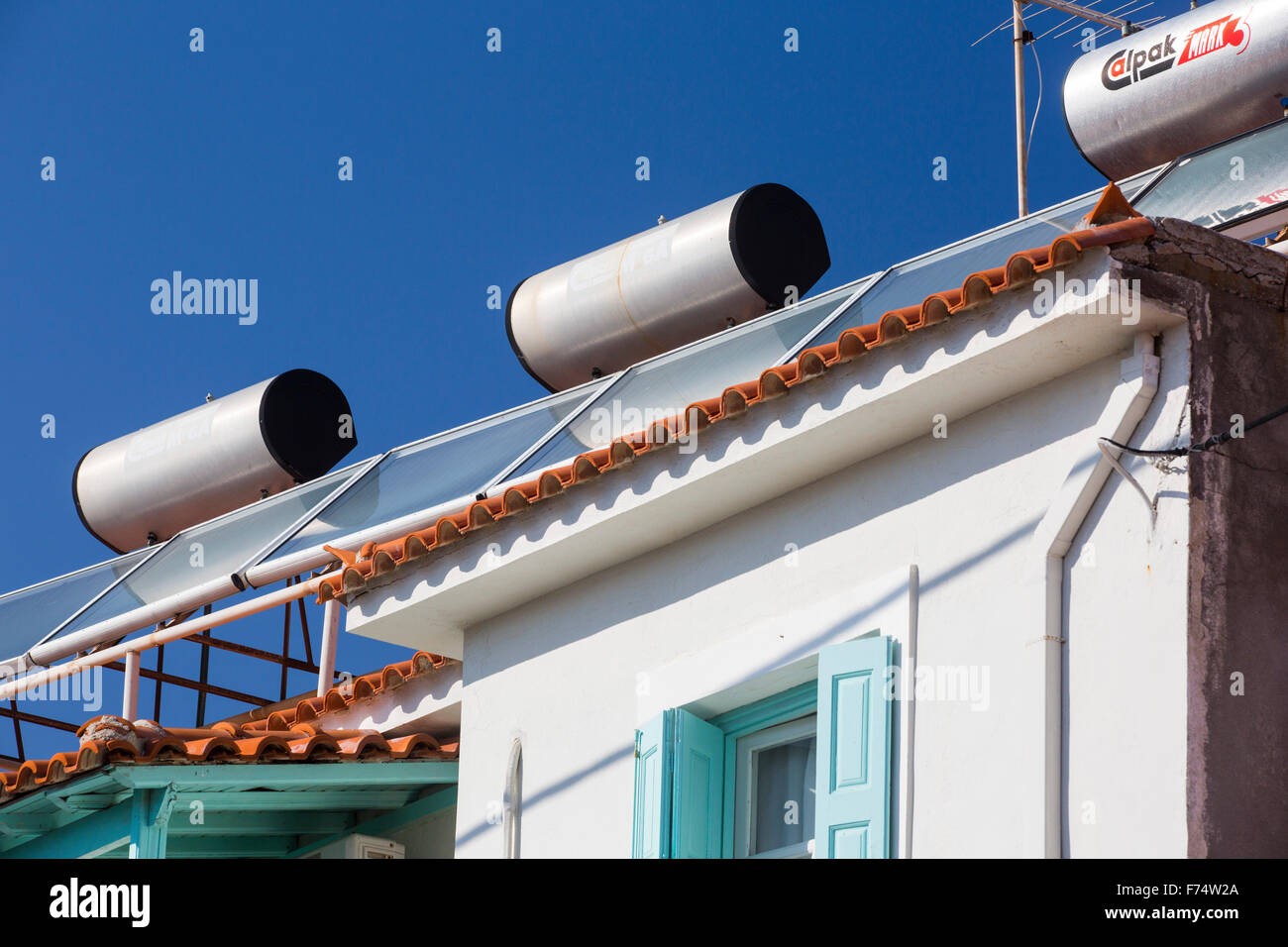 Accommodation with solar thermal water heating panels on the roof in Skala Eresou, on Lesvos, Greece. Stock Photo