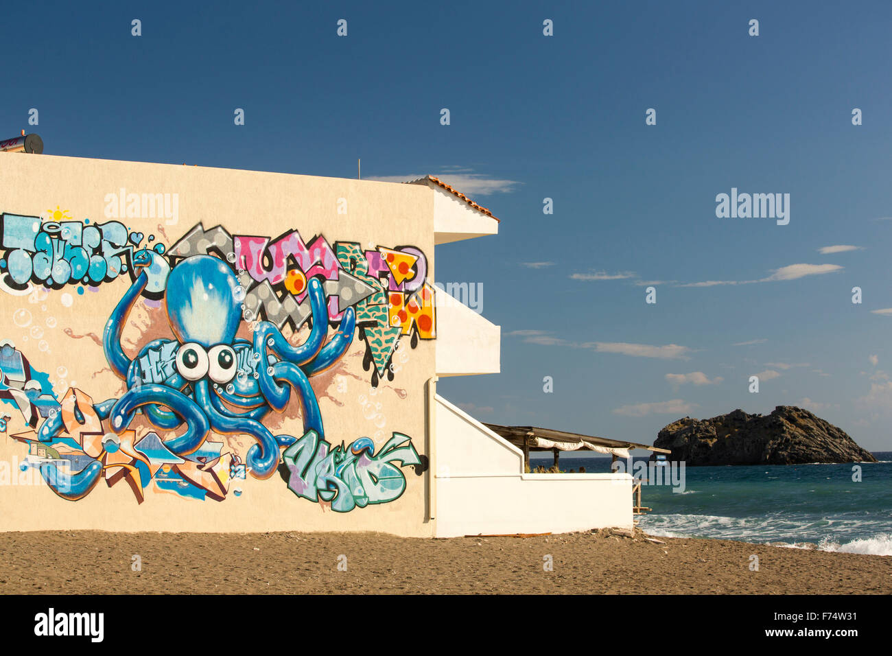 A hotel with an octopus mural on the wall in Skala Eresou, on Lesvos, Greece. Stock Photo