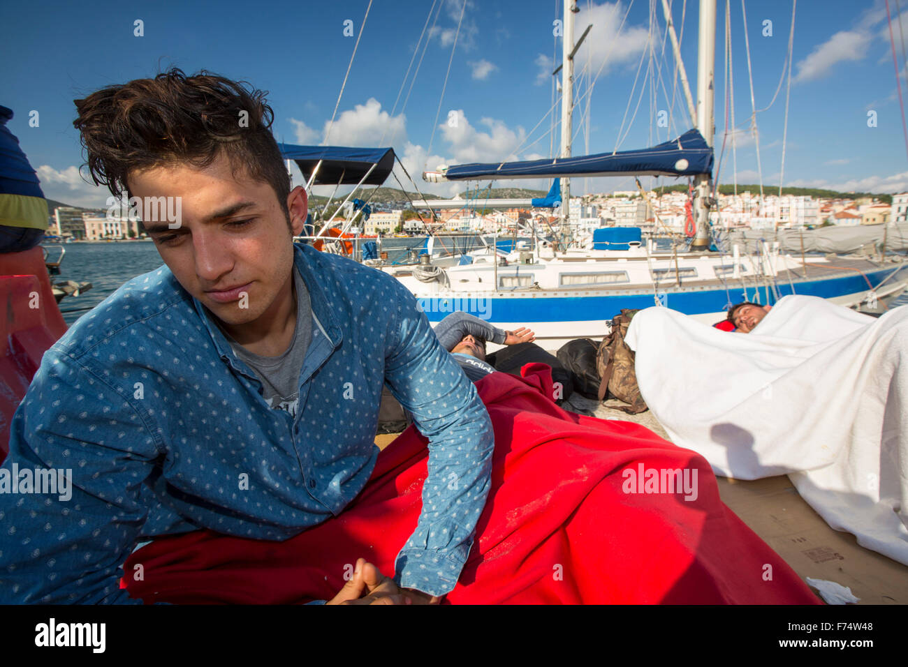 Syrian migrants fleeing the war and escaping to Europe,  who have landed on the Greek island of Lesvos on the north Stock Photo