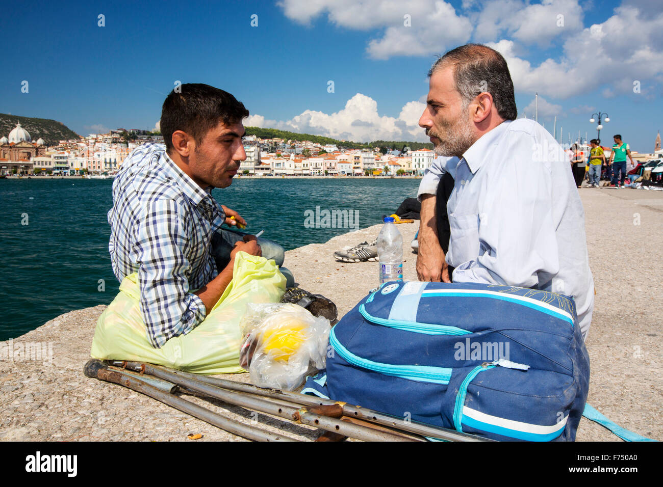 A disabled Syrian migrant who has fled the war and escaped to Europe, landing on the Greek island of Lesvos on the Stock Photo