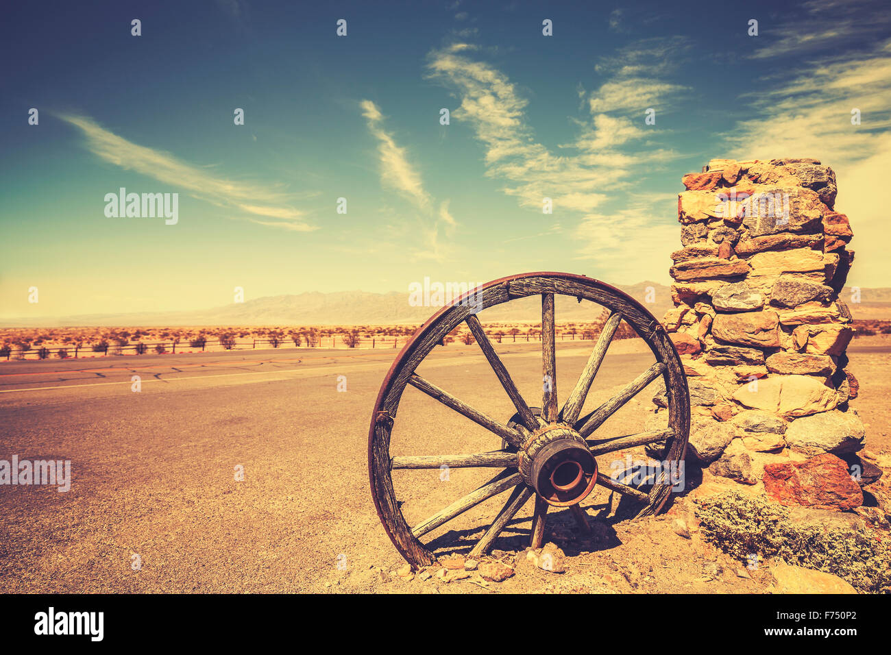 Retro style old cartwheel, wild west concept, Death Valley, USA. - Stock Image
