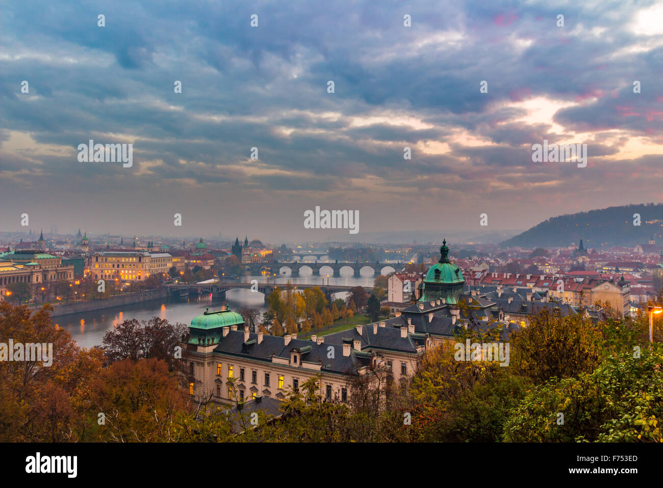 Prague and Vltava river from Letna Hill - Romantic view after misty sunset - European capital of bohemian Czech - Stock Image