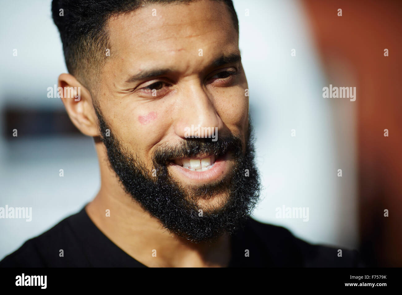 Manchester City and French national football soccer player  Gael Clichy   Asian beard scar face cheek talking headshot - Stock Image