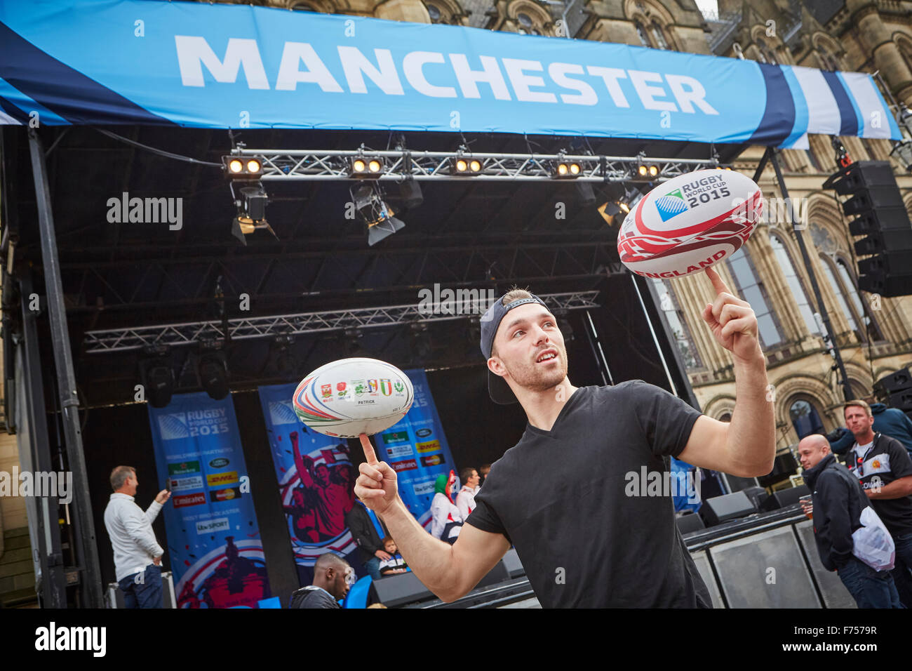 Rugby 2015 World Cup fanzine at Manchester Albert Square, blah skill display spinning finger - Stock Image
