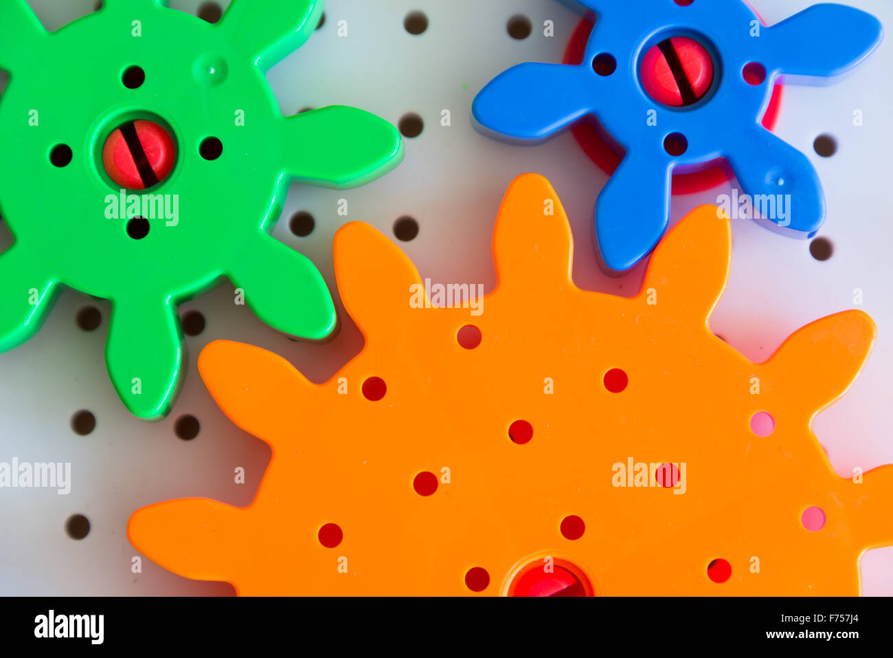 Gears from colorful children game - Stock Image