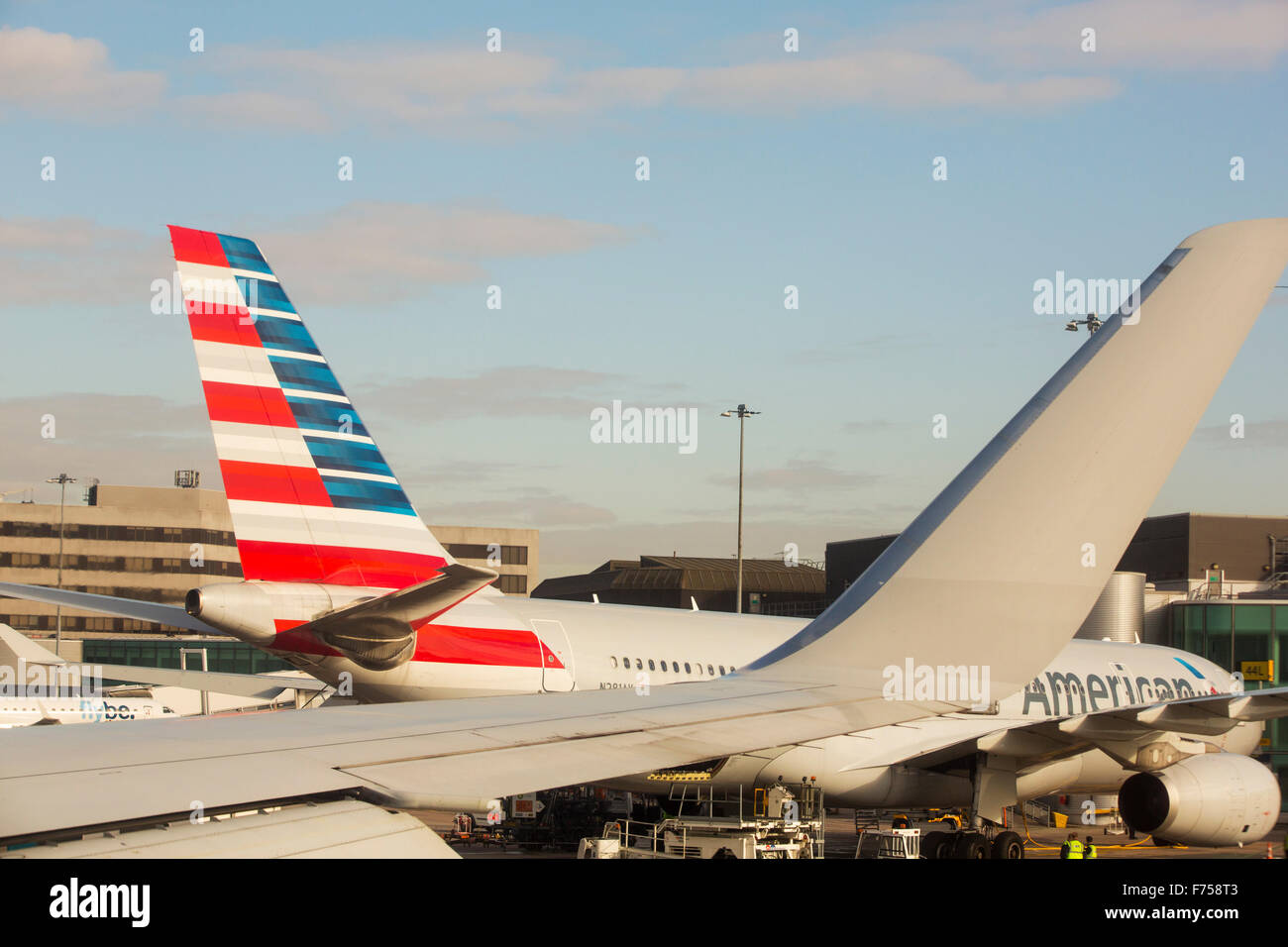 An American Airlines jet leaving Manchester airport, UK. - Stock Image