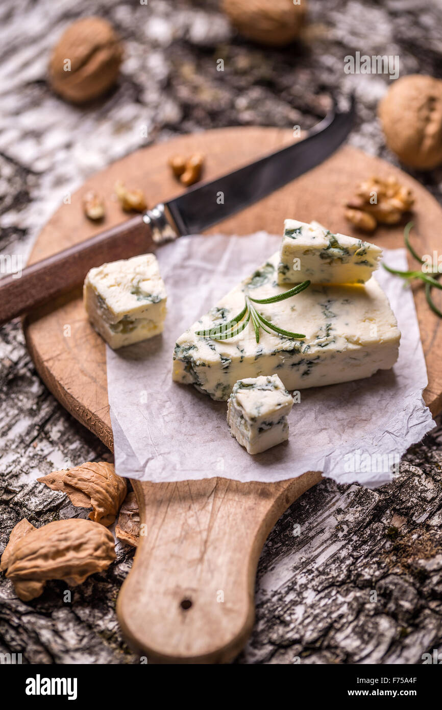 French gorgonzola soft cheese on wooden cutting board - Stock Image