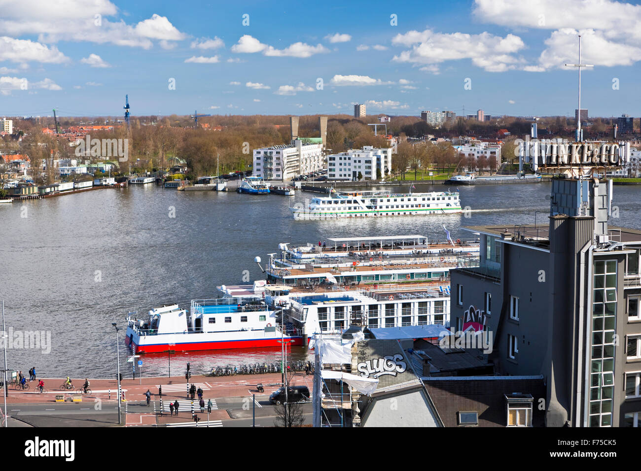 Image of ferry boats on the river IJ Amsterdam viewed from the rooftop of the Doubletree Hotel - Stock Image