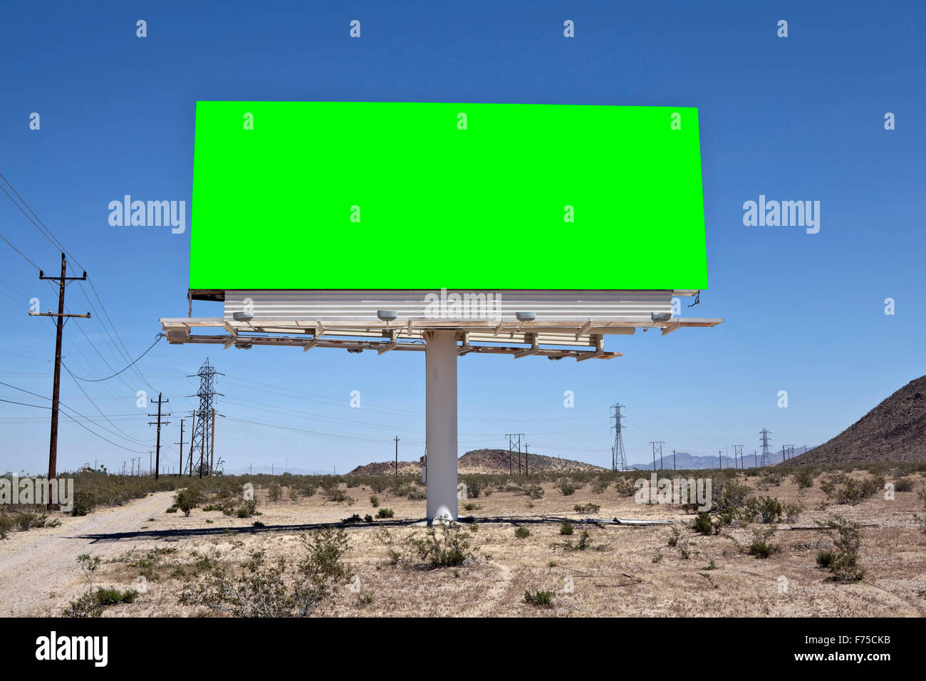 Green chroma key billboard in the middle of California's Mojave desert. - Stock Image