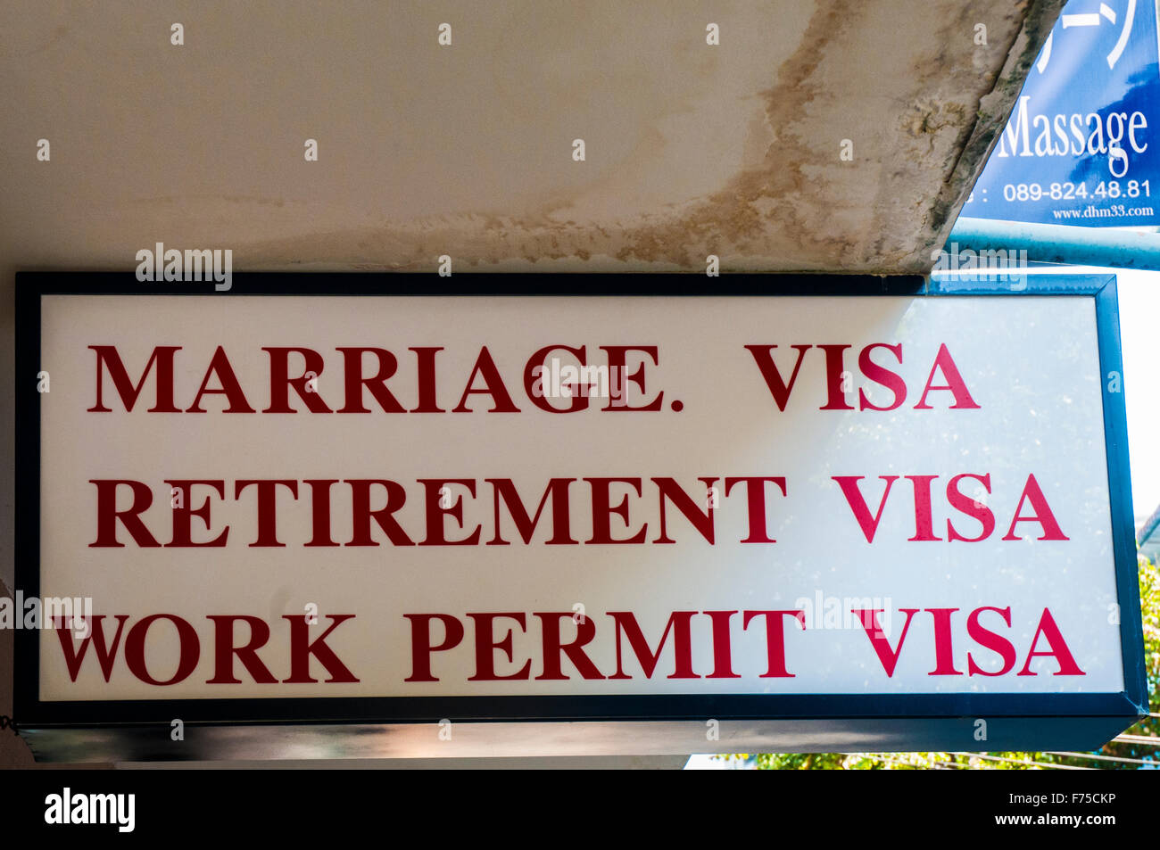 Sign touting visa procurement services for foreigners.  Bangkok, Thailand - Stock Image