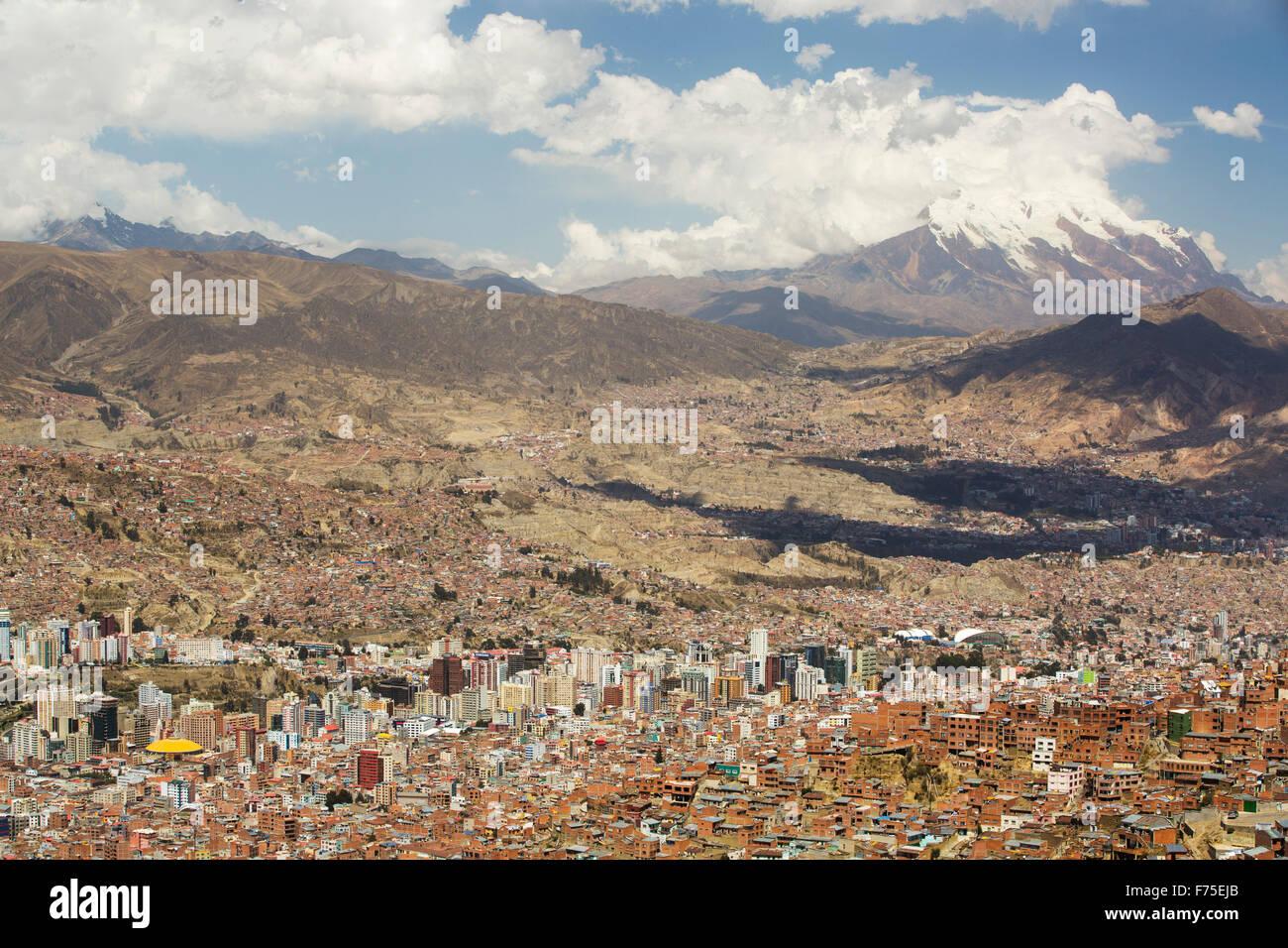 The peak of Illimani (6348 metres) from El Alto above, La Paz, Bolivia. La Paz and El Alto are critically short - Stock Image