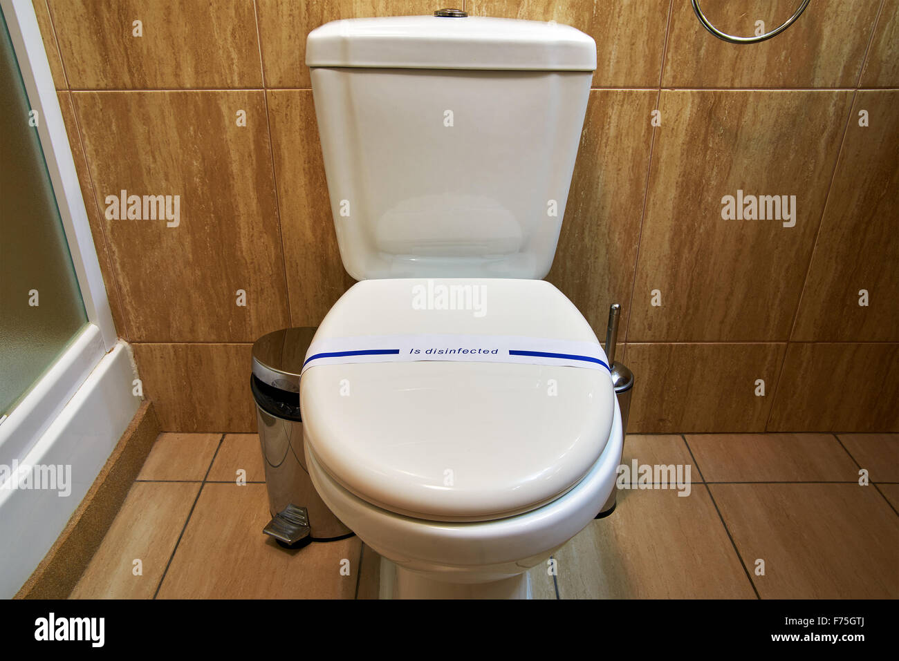 Flush toilet lavatory bathroom with disinfected sign Stock Photo ...