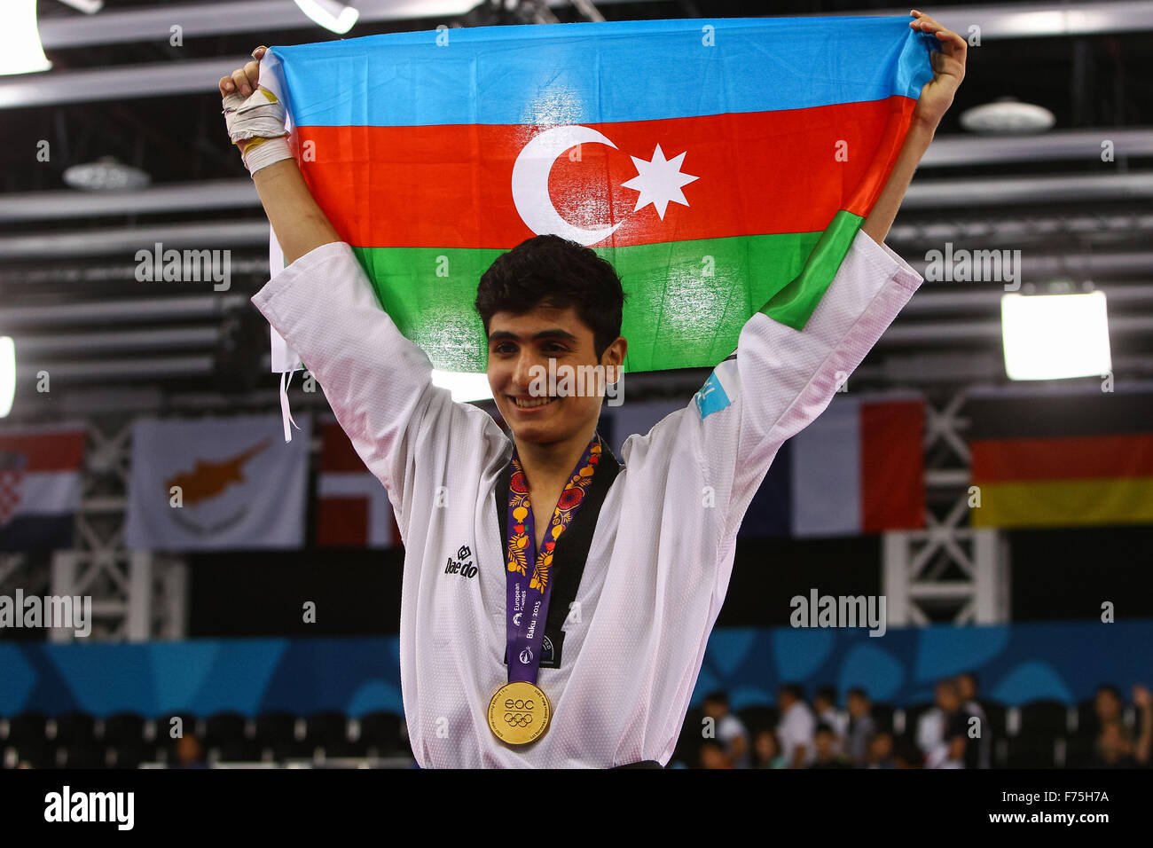 Aykhan Taghizade (AZE) celebrates after being presented with his gold medal. Taekwondo Men's 68kg Final. Crystal Stock Photo