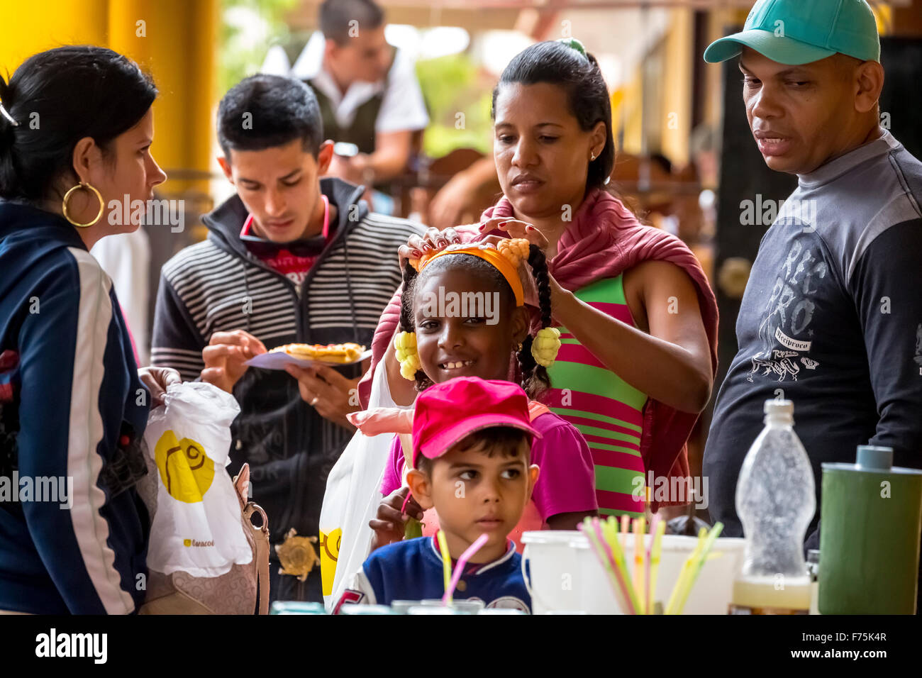 young girl with plaits on a lofty Cuban Pizza Stand with her family, Viñales, Cuba, Pinar del Rio, Cuba, - Stock Image