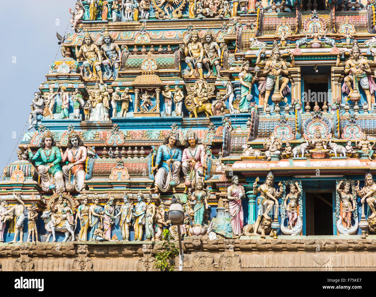 Traditional colourful carvings of Hindu deities on the facade of Kapaleeswarar Temple, a Hindu temple of Shiva in - Stock Image