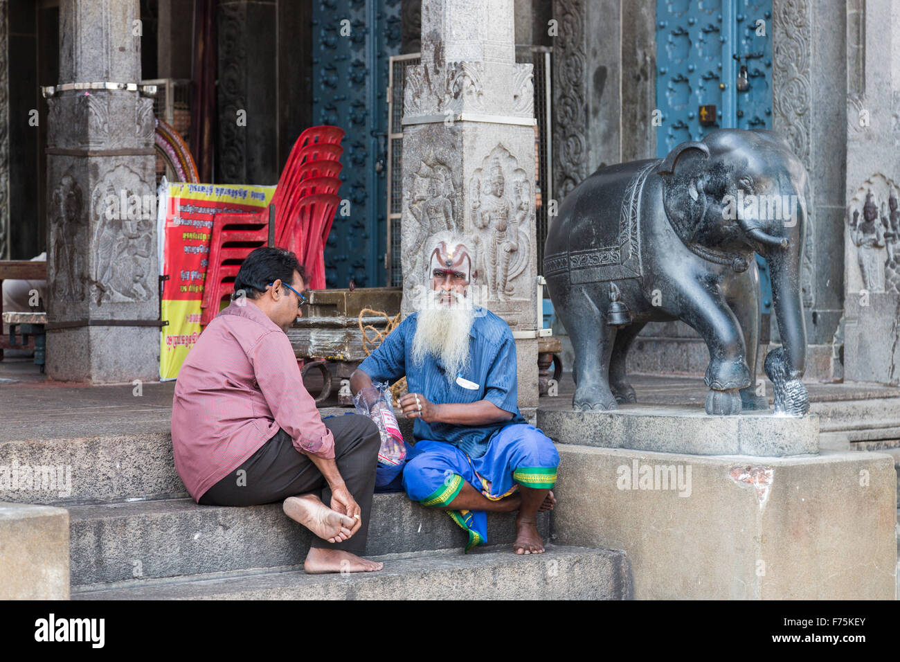 Sadhu holy man with long white beard and painted face at Kapaleeswarar Temple, a Hindu temple of Shiva in Mylapore, - Stock Image