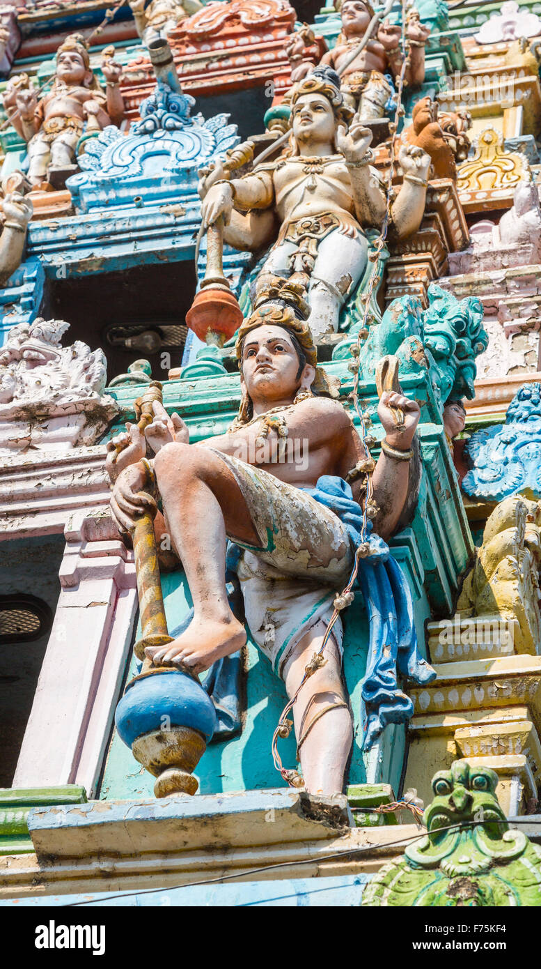 Typical colourful statues of traditional Hindu deities, Kapaleeswarar Temple, a Hindu temple of Shiva located in - Stock Image
