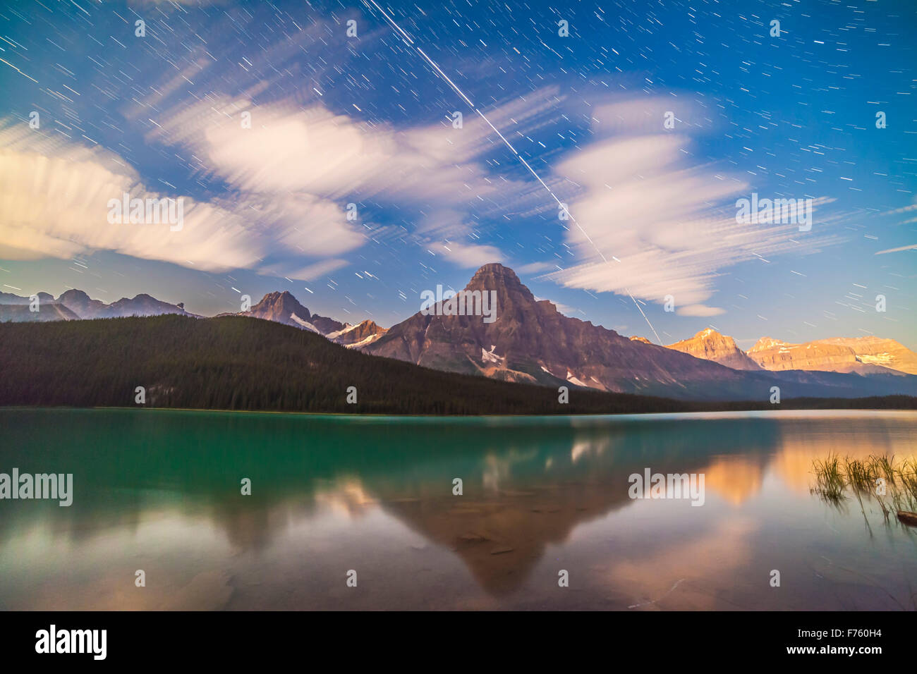 The Space Station passing from west to east (bottom to top here) over Waterfowl Lakes and Mt. Cephren, in Banff - Stock Image