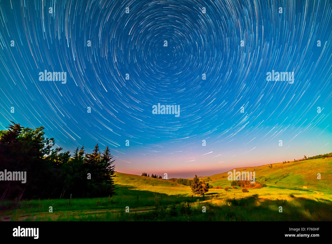Stars wheeling about the North Celestial Pole, and Polaris, in a composite stack of 100 frames shot July 8, 2014 - Stock Image