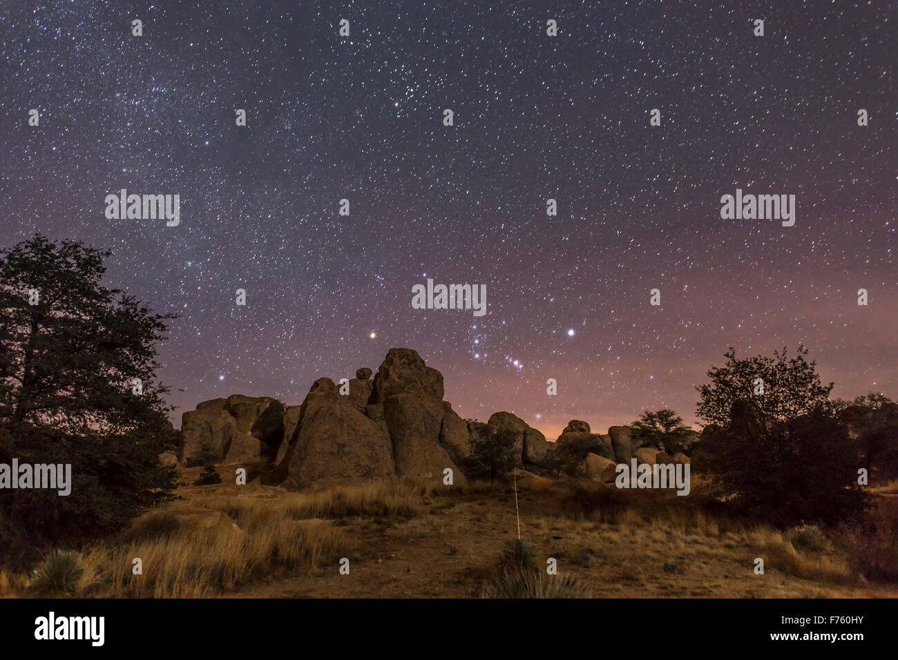 Orion rising at the City of Rocks State Park, New Mexico, on Christmas Eve, 2014. with light from the waxing crescent - Stock Image