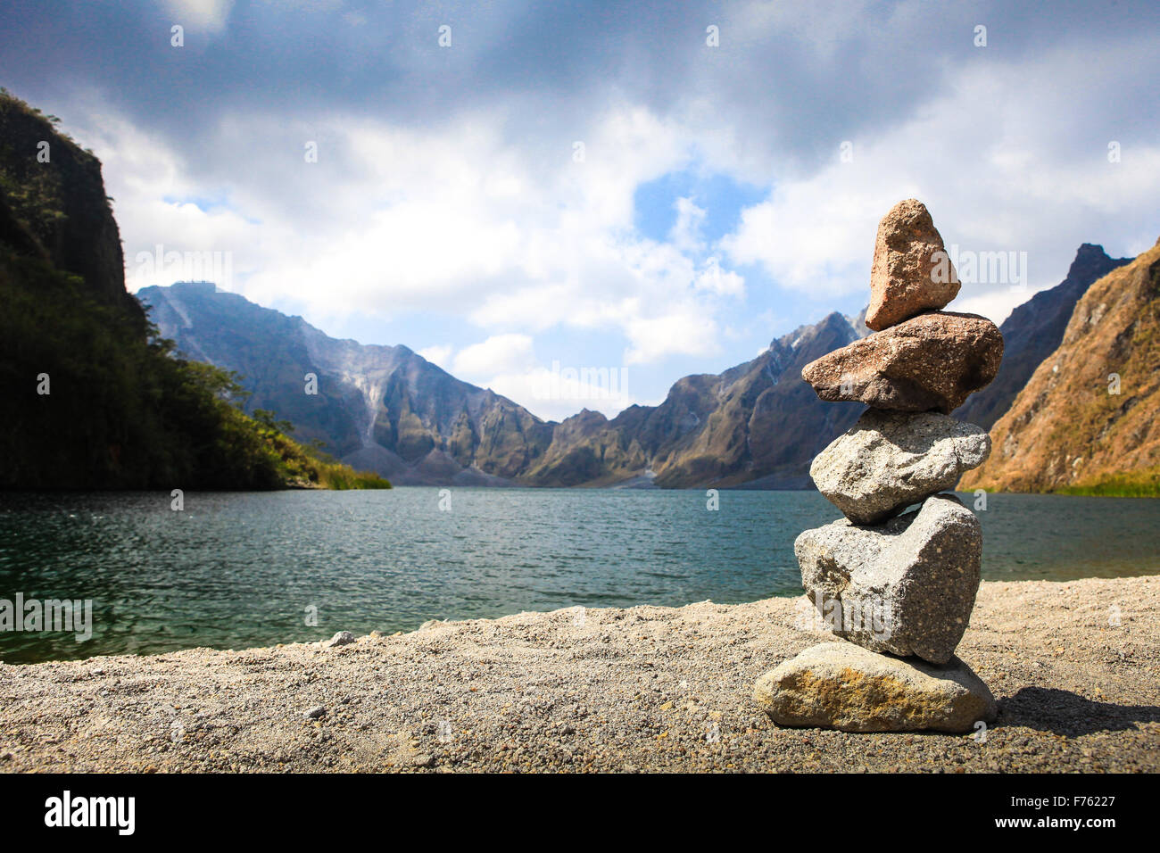 Pile of stones beside on the lake. Concept of balance and harmony. - Stock Image