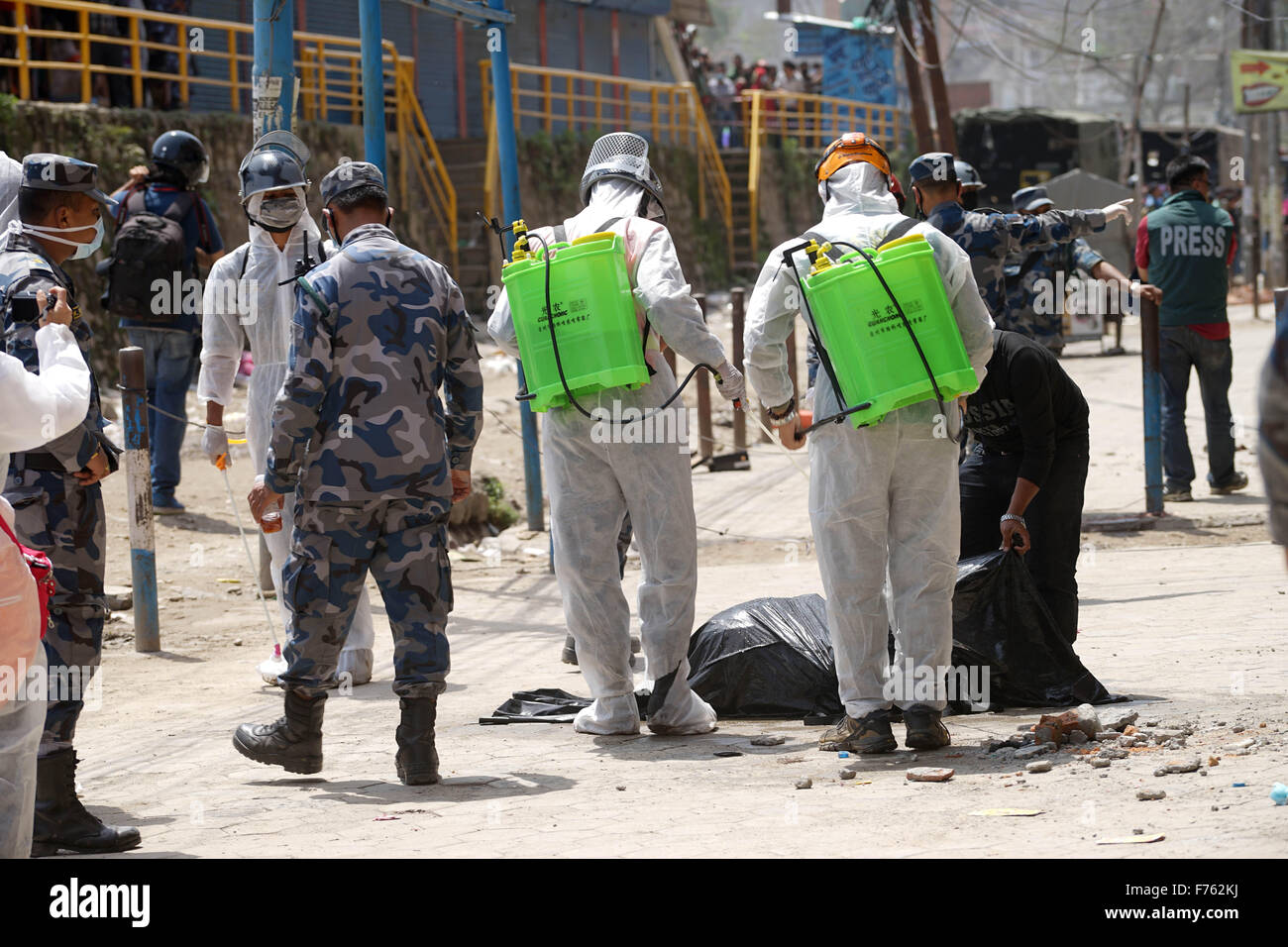 Rescue personnel spray disinfectant on dead body, gongabu, nepal, asia - Stock Image