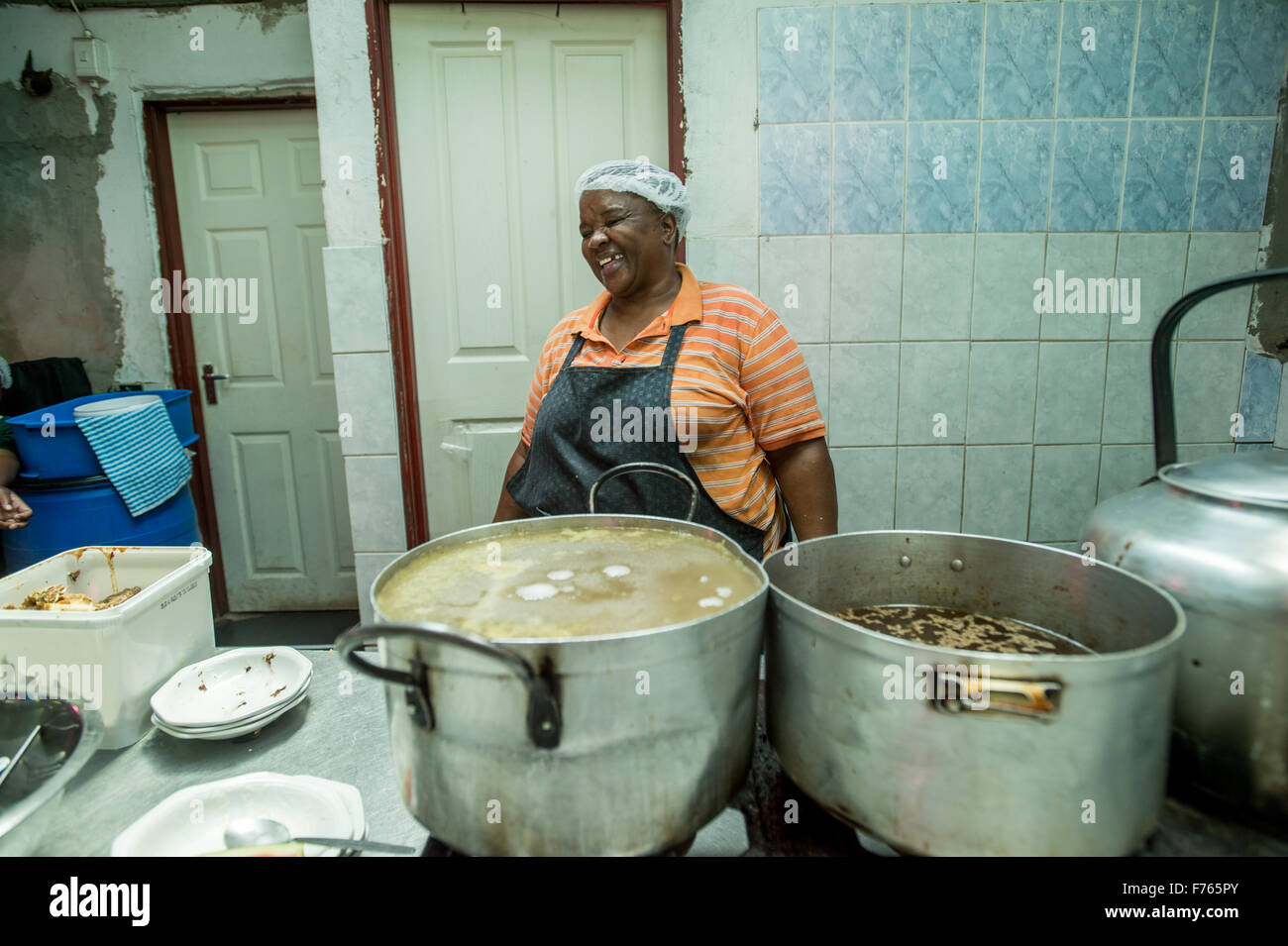 SOWETO, SOUTH AFRICA- Woman at the Chez Alina Restaurant - Stock Image