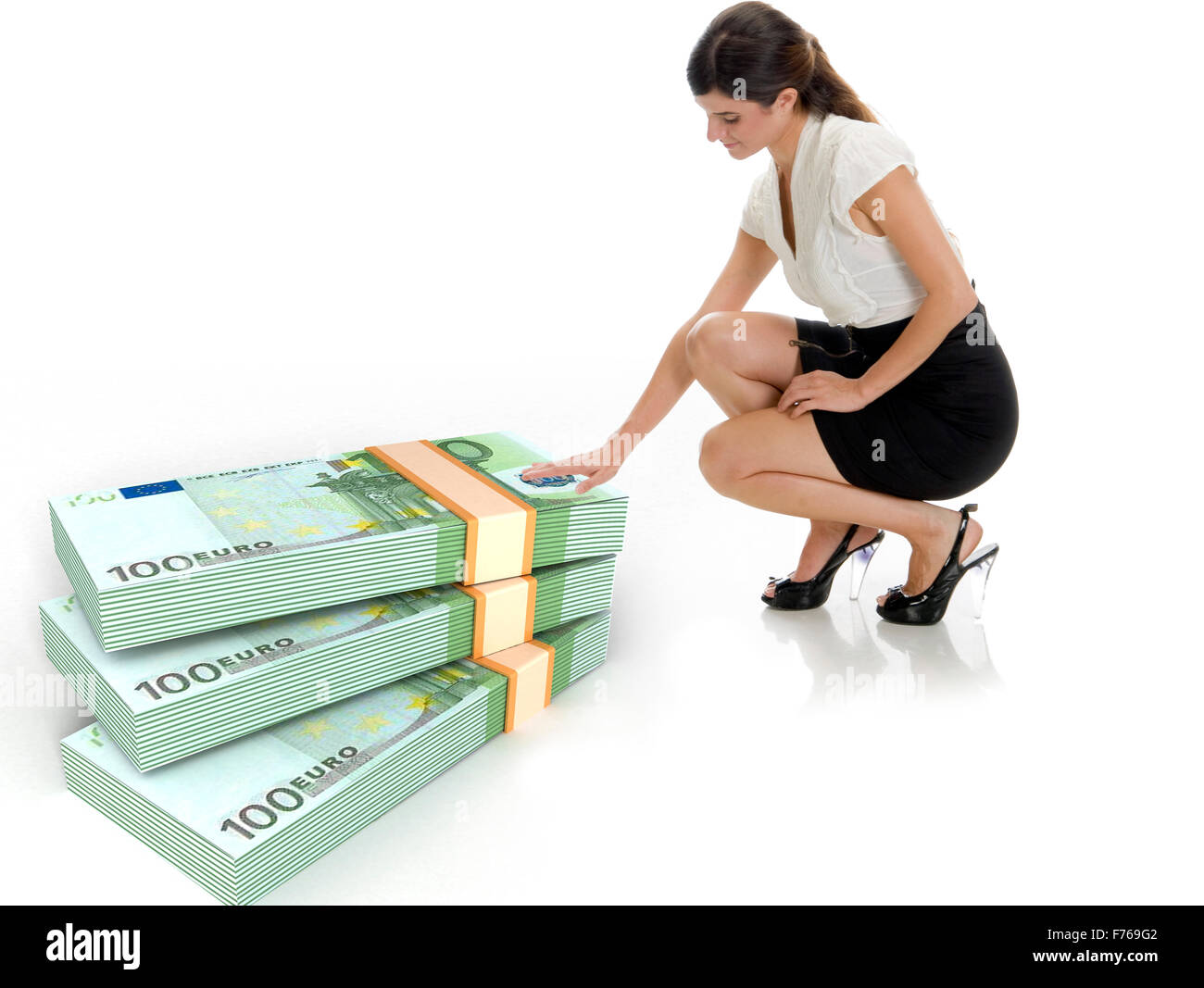 businesswoman and three dimensional bundles of europian currency - Stock Image