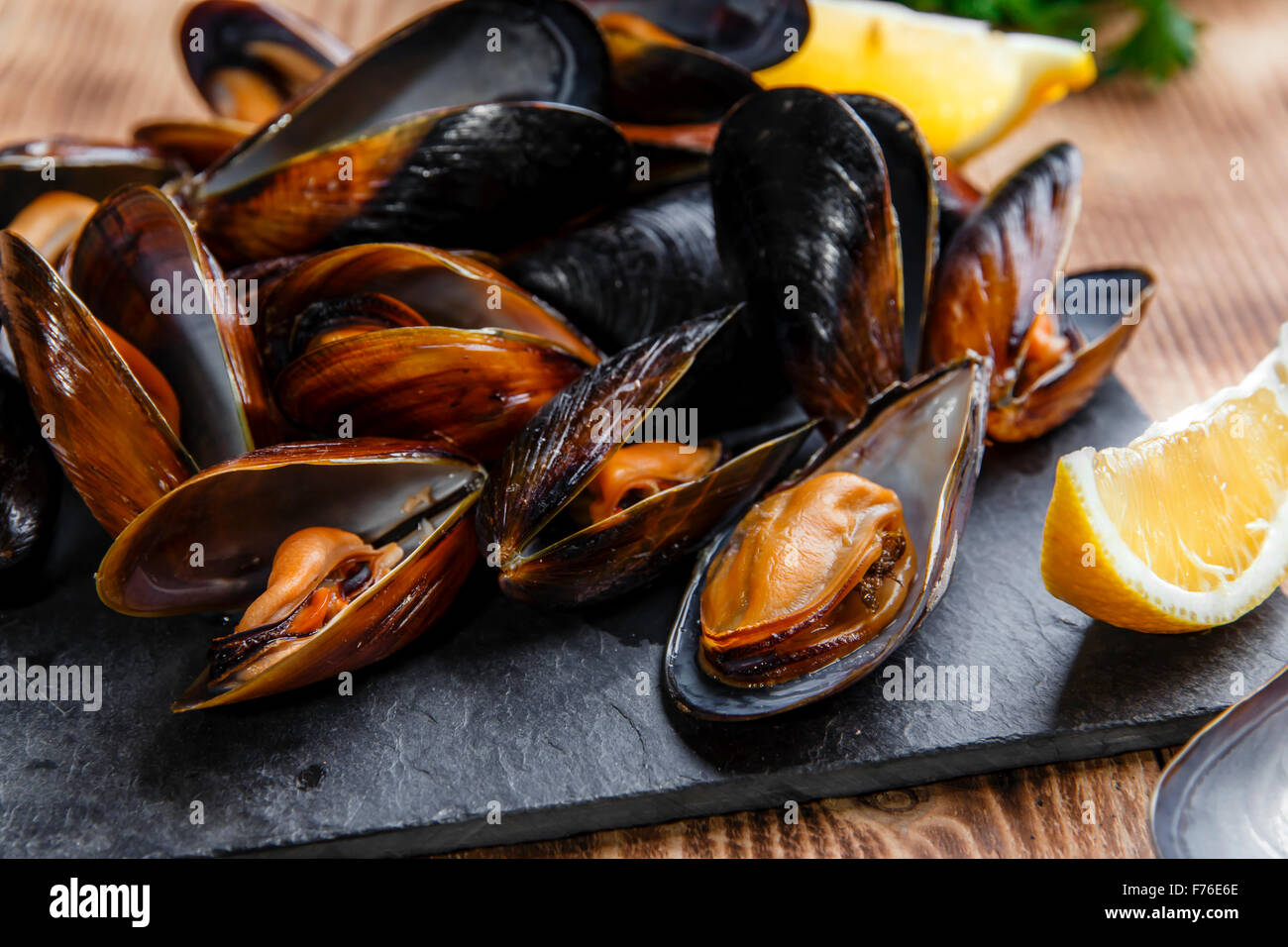 mussels steamed oysters with lemon and herbs - Stock Image