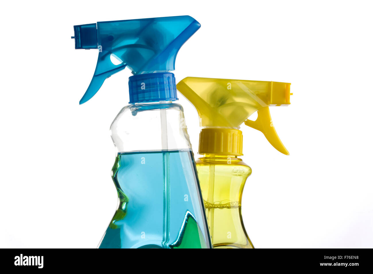blue and yellow trigger spray bottles - Stock Image