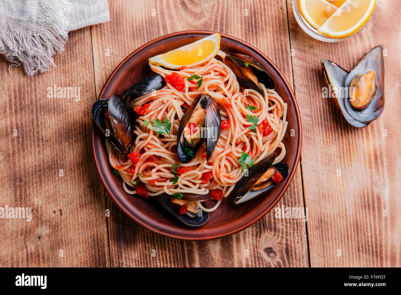 spaghetti with mussels oyster in tomato sauce - Stock Image