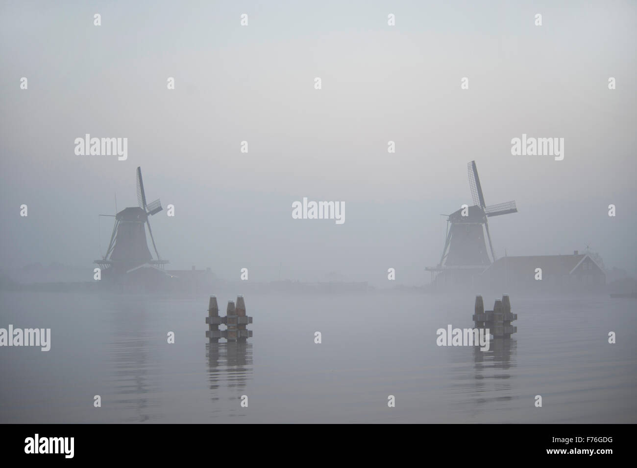 windmills in morning fog the Netherlands, Zaanse SchansStock Photo