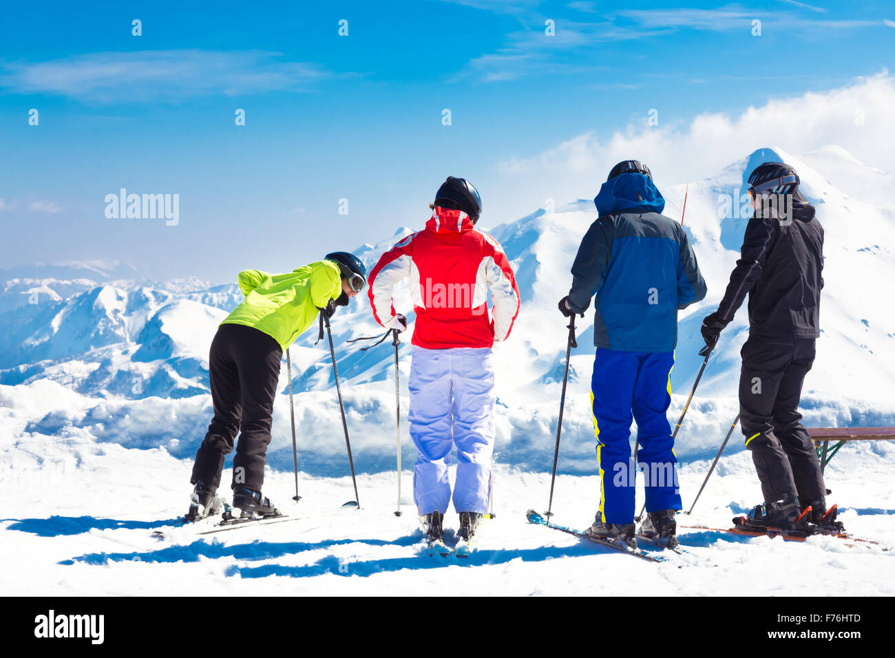 Group of friends skiing. - Stock Image
