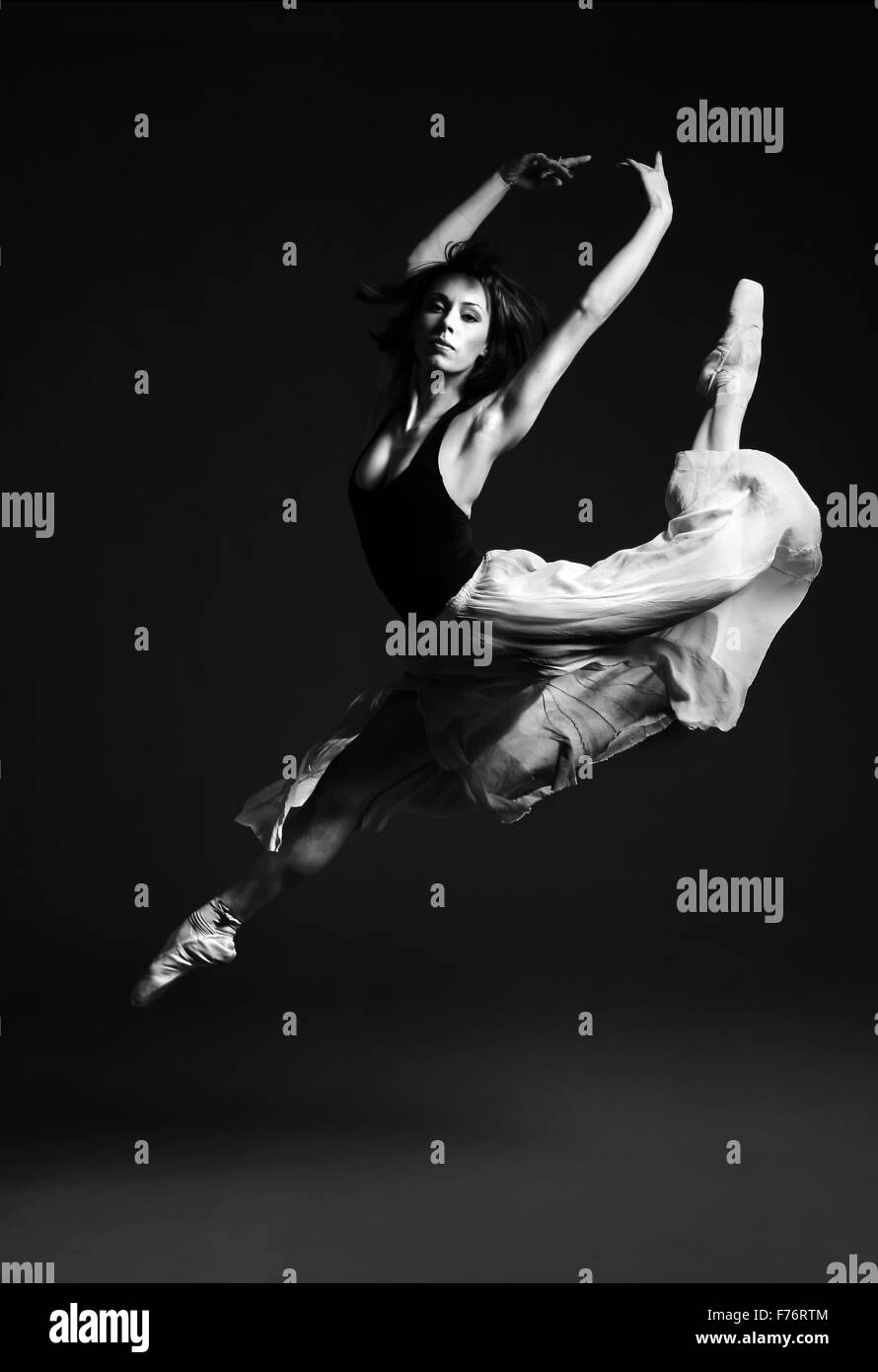 Ballet dancer in striking flying pose, black and white image - Stock Image
