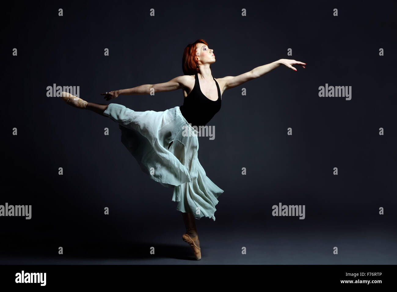 Ballet dancer performing on stage - Stock Image