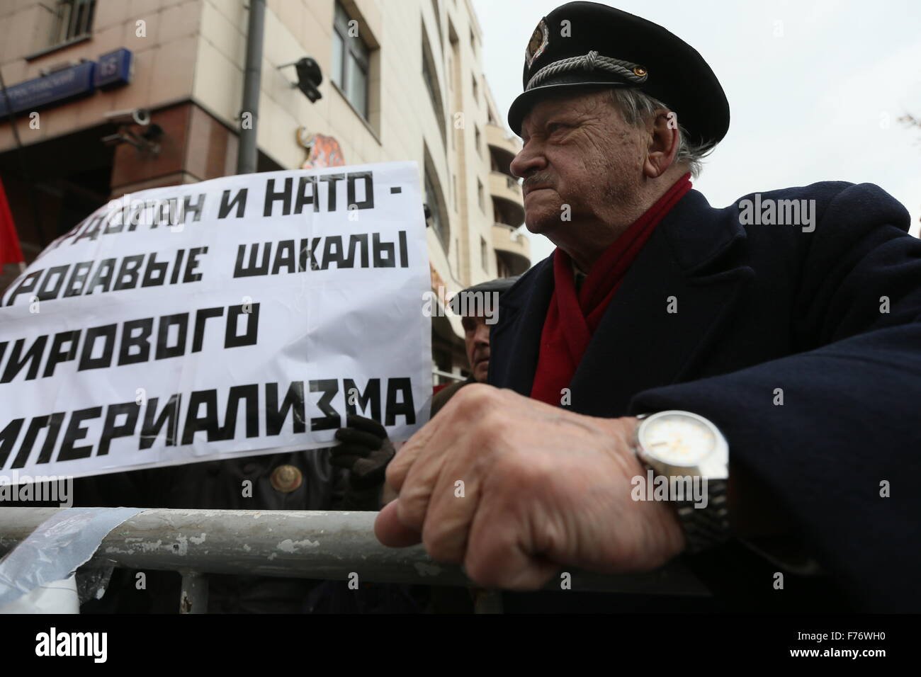 MOSCOW, RUSSIA. NOVEMBER 26, 2015. A man holds a sign with a message reading 'Erdogan and the NATO are jackals - Stock Image